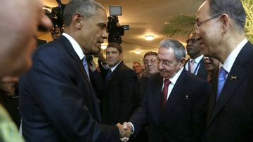 US President  Barack Obama shakes hands with Cuban President Raul Castro. (AFP)