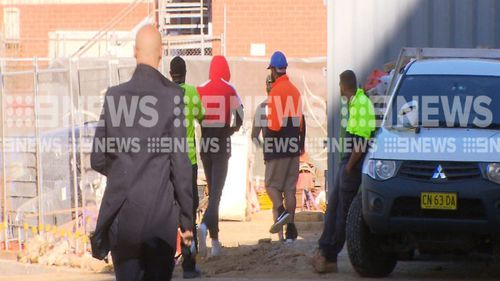 El Zien ran through a construction site to avoid waiting media as he left court today. (9NEWS)
