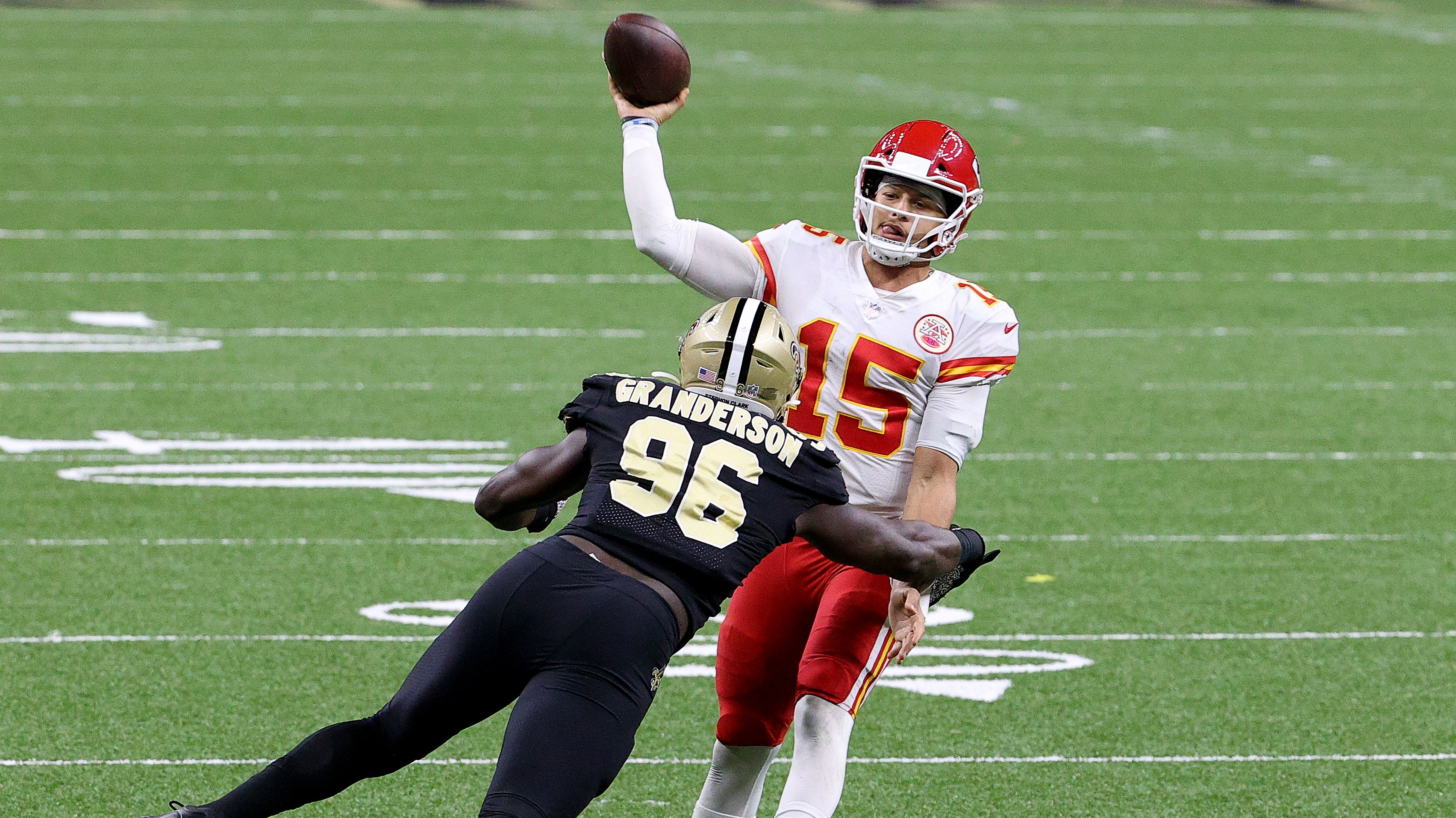 Patrick Mahomes of the Kansas City Chiefs throws under pressure by Carl Granderson of the New Orleans Saints.