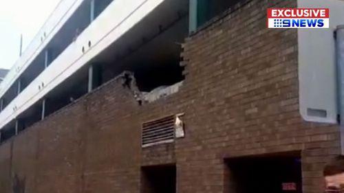 Sydney news Eastwood car crash shopping centre BMW flip
