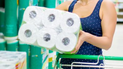 Woman shopping for toilet paper