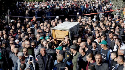 Mourners carry the coffin of student Aya Maasarwe, who was killed in Melbourne, during the funeral at her hometown of Baqa al-Gharbiya, Israel.