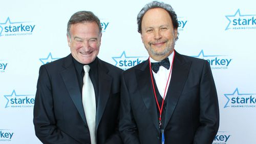 In happier times: Robin Williams and Billy Crystal. Crystal will deliver an 'in memoriam' address during the ceremony.