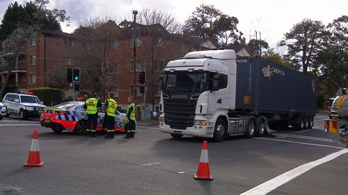 The woman, who has not been formally identified, died at the scene and the truck driver was taken to hospital for mandatory testing. Picture: 9NEWS.