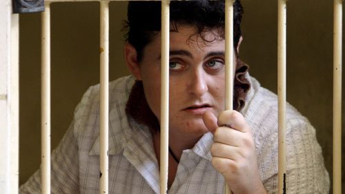 Australian alleged drug suspect Renae Lawrence inside a holding cell before trial at a Denpasar District Court in Bali, Indonesia on Friday 13 January 2006.