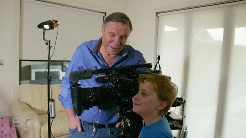 Darcy, 9, tries out the camera. (60 Minutes)