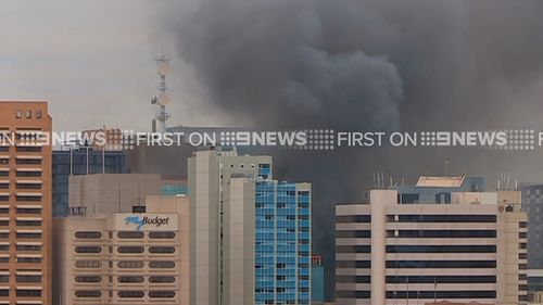 Smoke covers the Adelaide CBD after a fire broke out at the Hotel Grand Chancellor. (9NEWS)