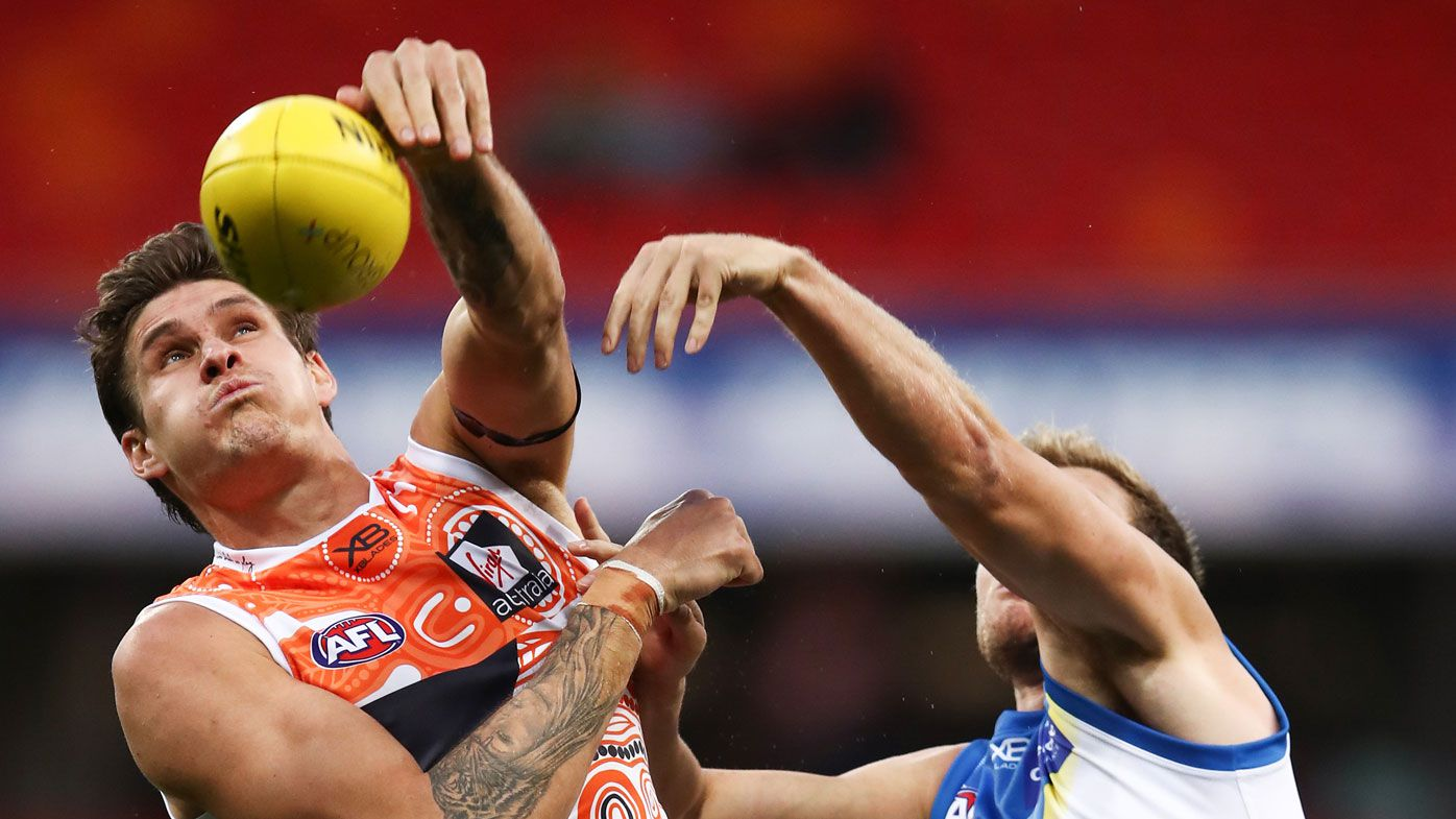 Two Giants hurt in huge AFL win over Suns