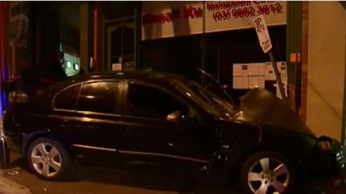 The car took out a ticket machine and crashed into a wall on Burke Road. (9NEWS)