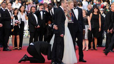The intruder sticks his head under America Ferrera's dress. (Getty)
