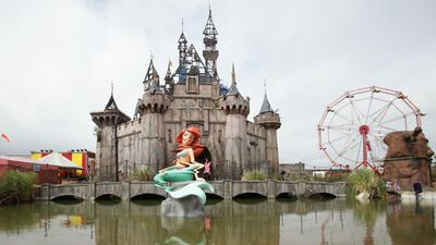 "Mysterious British artist Banksy has unveiled his biggest work to date – a creepy ""bemusement park"" called Dismaland.<br><br>Featuring pieces by the man himself and other contemporaries, the new theme park exhibition was built in an abandoned beachside area in Western-super-Mare in Somerset, England.<br><br><strong>Click through to see inside the confronting show.</strong>"