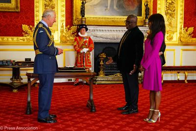 Prince Charles awards actor Rudolph Walker a CBE
