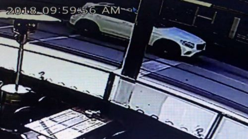 Bystanders helped the driver from the car, with the man pausing to retrieve his belongings from the boot of the vehicle before fleeing the scene.