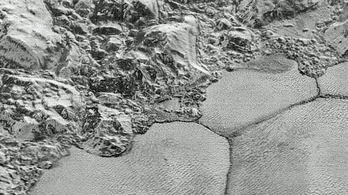 The Pluto plains known as Sputnik Planitia with the methane dunes on the bottom  half of the image. (Photo: AP).
