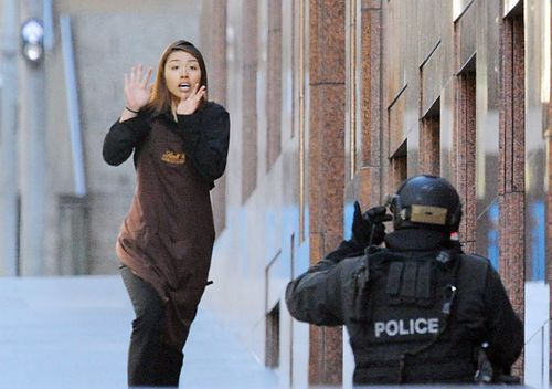 Sydney Siege hostage Elly Chen runs from the Lindt Cafe in Martin Place, Sydney, on December 15 2014.