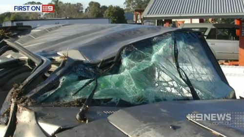 The driver and a young boy suffered minor injuries. (9NEWS)