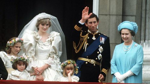 The Prince and Princess of Wales pose on the balcony of Buckingham Palace on their wedding day, with the Queen and some of the bridesmaids on July 29, 1981. (Getty)