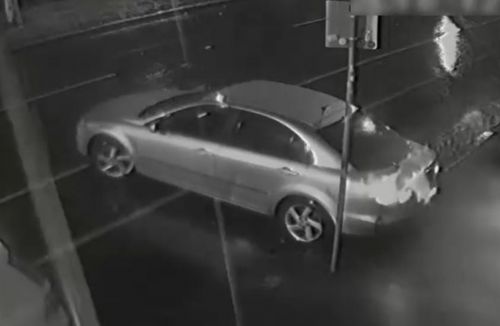 The two individuals used a Mazda sedan to break down the front door of a clothing store on Elgin Street, Carlton.