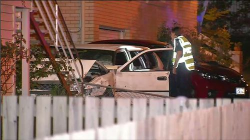 A teenager has been killed in a horror crash in Brisbane where a car came off a road, smashed through a fence and collided with a home.