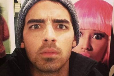 Like something out of a celebrity horror film, Joe Jonas was the unsuspecting victim of a cardboard Nicki Minaj photobomb when he snapped this confusion-stricken selfie.<br/><br/>Image: Twitter @joejonas
