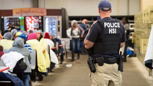 A handout photo made available by the US Department of Homeland Security showing US Immigration and Customs Enforcement (ICE) Homeland Security Investigations (HSI) executing multiple federal criminal search warrants