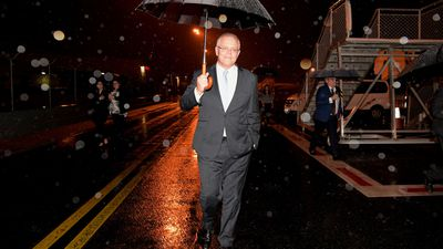 Scott Morrison leaves a media conference following the passing of Bob Hawke, at Brisbane Airport.