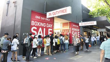Shoppers line up outside a store in Melbourne on Boxing Day.