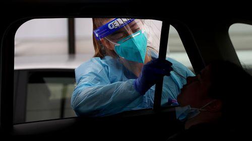 Registered Nurse Ellie Taylor conducts a COVID-19 test at the Bondi Beach testing clinic on November 04, 2020 in Sydney, Australia.