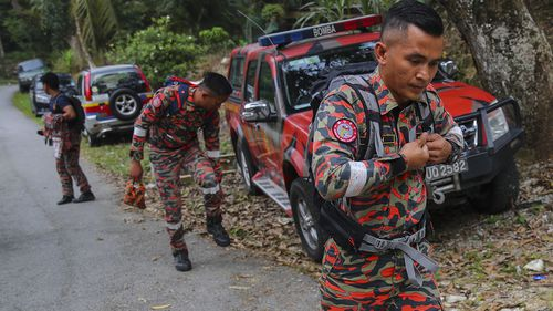 Members of a Malaysian Fire and Rescue Department team continue a search and rescue operation for 15-year-old Nora Quoirin.