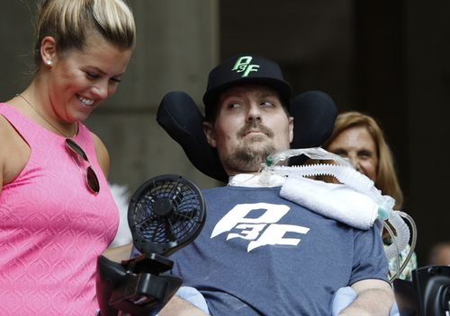 Pete Frates, who inspired the ice bucket challenge, looks at his wife Julie during a ceremony at City Hall by Boston Mayor Marty Walsh. September 5, 2017 was declared 'Pete Frates Day'. Frates, who was stricken with ALS died on Monday.