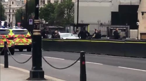 A man has been arrested after crashing into a security barrier outside the UK Houses of Parliament in London.