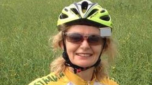 Woman killed in crash outside Brisbane hospital a keen traveller who 'cycled around the world'