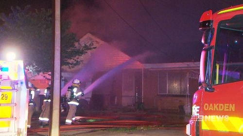 A father has told of his family's close-call with a blazing inferno that has destroyed his house. Picture: 9NEWS.