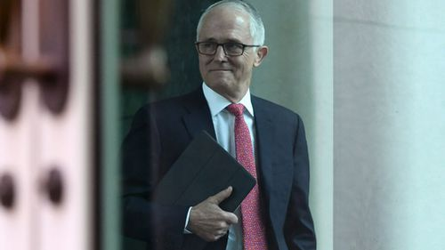 Malcolm Turnbull grins confidently as he enters the Liberal Party meeting ahead of a leadership vote.