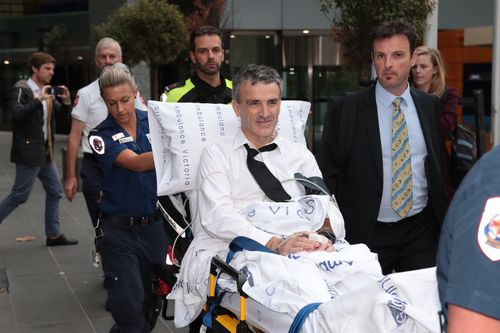 He was wheeled from the court room on a stretcher. (AAP)