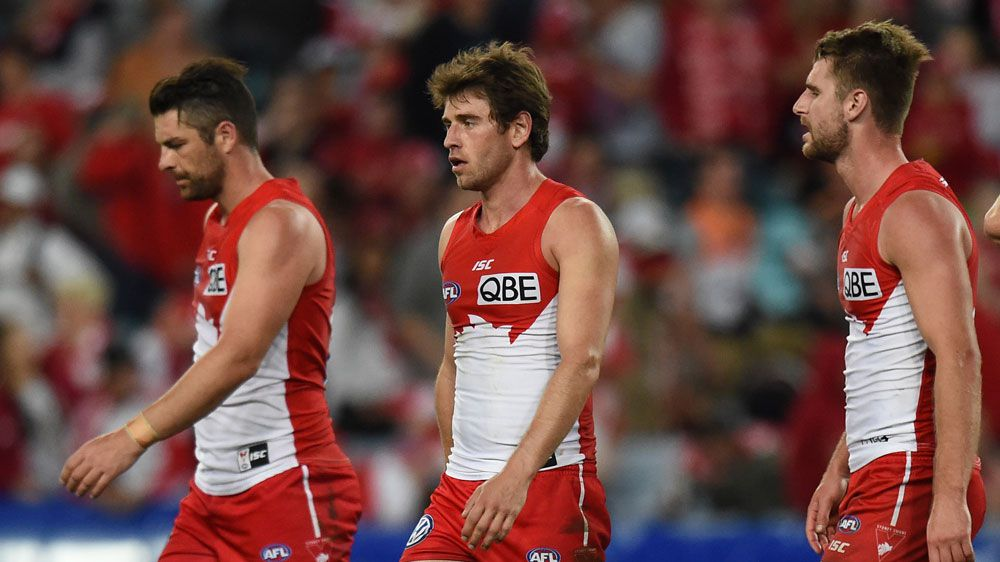 A dejected Heath Grundy, Nick Smith and Toby Nankervis of the Swans after their loss to the Giants.(AAP)