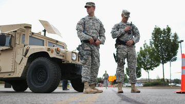 Missouri National Guard troops are deployed to provide protection for a police command center in Ferguson, Missouri. (Photo by Joe Raedle/Getty Images)