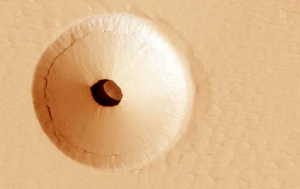 NASA reveal mystery hole on Mars that could 'contain Martian life'