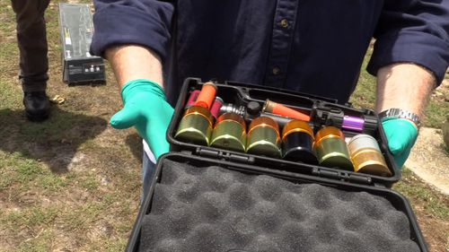Police also seized a number of gas-propelled, grenade-like canisters.