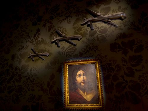 "A wall decorated with models of drones and a painting of Jesus with a sniper's dot on his forehead is seen in ""The Walled Off Hotel"". (AAP)"