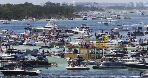 """Boaters crowd an area known as """"Crab Island"""" in the shallow waters near Destin,  Florida"""