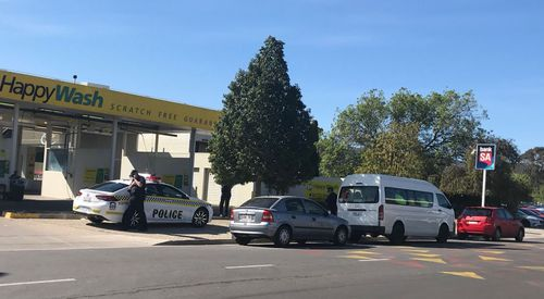 A van carrying pre-release inmates stopped at the service station when the prisoner wandered off.
