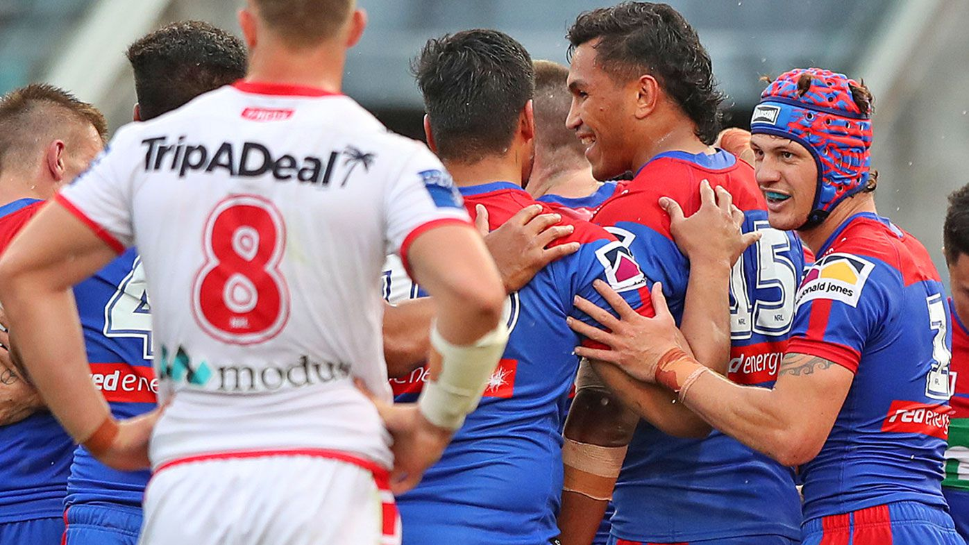 Newcastle Knights players celebrate a try during round 19