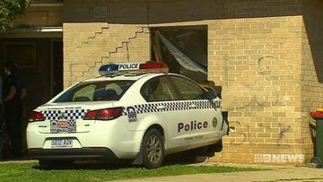 'Airborne' police patrol car crashes into home