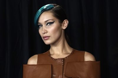 <p>Models of the moment Bella and Gigi Hadid, Kendall Jenner and Kaia Gerber have strutted down the Fendi runway and debuted killer new hair colour.</p> <p>All four of the women sported nearly identical side-swept bangs in the boldest hues and the result was super sophisticated and seriously cool. The quartet all professed to love the look - Bella especially so. Indeed, she took one look at herself and broke into a broad grin. Given she's famed for her poker-faced expression, that's saying something.</p> <p>The look, created by stylist Sam McKnight, saw custom-made hair-pieces in shades of aqua blue (and occasionally sea green and even deep grey) attached to the side of each model's hair part. To maximise the bad-gal feel, the models wore graphic, winged liner in rich shades of blue-ish black.</p> <p>Oh and there were clothes too. And they were almost as incredible as the beauty looks. Leather that draped and fell in exquisite shapes, handbags in edgy designs and soft, sheer feminine pieces that made the rock chick feel all the more appealing.</p> <p>Click through and see all that and more - including Bella with one big-ass smile. Frankly, it's not to be missed.</p>