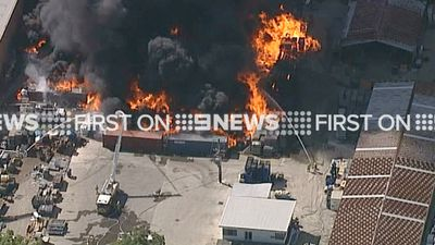 Firefighters attempted to contain the blaze before it spread to nearby buildings. (9NEWS)