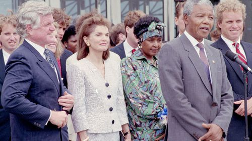 Nelson and Winnie Mandela meet with members of the Kennedy family, including Ted Kennedy, Jacqueline Kennedy Onassis, and Joe Kennedy in Boston during a 1990 tour of the US. (Getty)