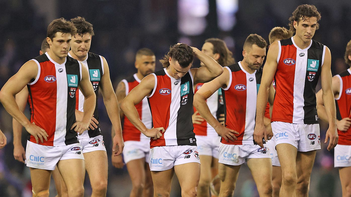 The Saints walk off after they were defeated by the Bulldogs