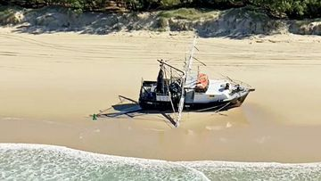 A fishing trawler has been beached on a Gold Coast beach following rough waves yesterday.