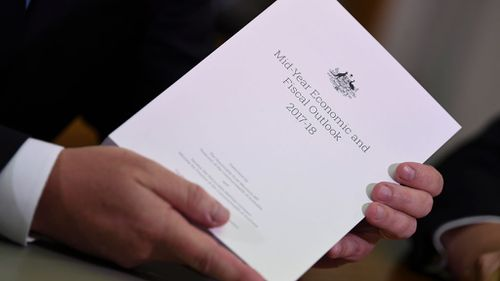 The MYEFO includes a $6 billion reduction in the deficit. (9NEWS)